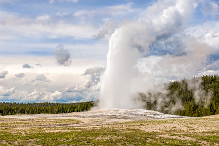 geologists: Geyser Old Faithful in Yellowstone National Park