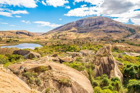 anja: ANJA,MADAGASCAR - AUGUST 03,2015 - The Anja Community Reserve is a woodland area and freshwater lake, situated at the base a large cliff. Much of the reserve is dominated by fallen rocks and boulders and there are two small caves providing habitat for bat
