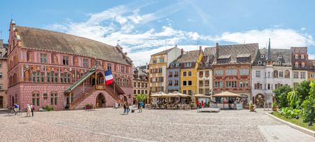 german swiss: MULHOUSE,FRANCE - AUGUST 28,2015 - At the Place de la Reunion in Mulhouse. Mulhouse is a city and commune in eastern France, close to the Swiss and German borders. Editorial