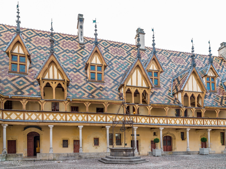 almshouse: BEAUNE,FRANCE - AUGUST 28,2015 - The Hospices de Beaune is a former charitable almshouse in Beaune. It was founded in 1443 by Nicolas Rolin, chancellor of Burgundy, as a hospital for the poor. Editorial