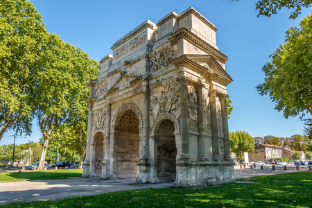 unrelated: ORANGE,FRANCE - AUGUST 29,2015 - Ancient Roman Triumphal Arch of Orange.Roman Orange was founded in 35 BC by veterans of the Second legion.The name was originally unrelated to that of the orange fruit.