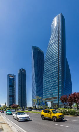 cristal: MADRID, SPAIN - APRIL 26.2016 - Four Towers Business Area of ??Madrid. The area contains the tallest skyscrapers in Spain The Torre Espacio (224 m), Torre de Cristal (249 m), Torre PwC (236 m) and Torre Cepsa (248 m).