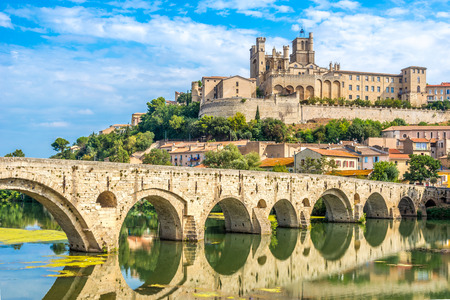 Panoramic view at the Old Bridge over Orb river with Cathedral of Saint Nazaire in Beziers Stock Photo