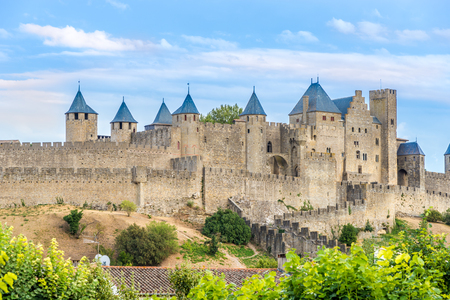 essentially: CARCASSONNE,FRANCE - AUGUST 29,2016 - Carcassonne is a fortified French town in the Aude department.The fortified city itself consists essentially of a concentric design of two outer walls with 53 towers and barbicans