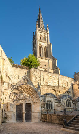 saint emilion: Bell tower with Monolithic church of Saint Emilion in France Stock Photo