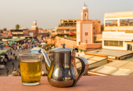 Refreshing with mint tea at the roof near Jemaa el-Fnaa square in Marrakesh Medina - Morocco