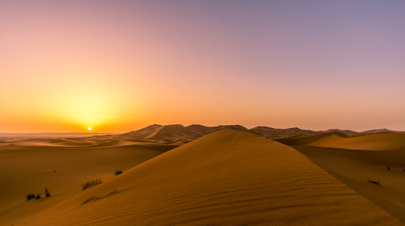 Sunrise over the sand dunes of Sahara in Morocco