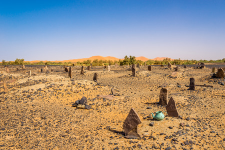 Merzouga, Morocco - APRIL 4.2017 - Nomads cemetery in area of ??Mezouga. A nomad is a member of a community of people WHO live in different locations, moving from one place to Another.