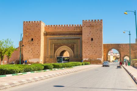 MEKNES,MOROCCO - APRIL 7,2017 - Gate Bab El-Khemis in Meknes. Meknes is one of the four Imperial cities of Morocco. Редакционное