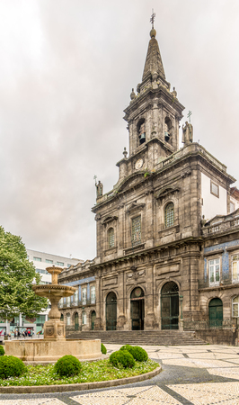 PORTO, PORTUGAL - MAY 13,2017 - Trindade church in the streets of Porto. Porto is one of the oldest European centers, and its historical core was proclaimed a World Heritage Site by UNESCO in 1996. Editorial