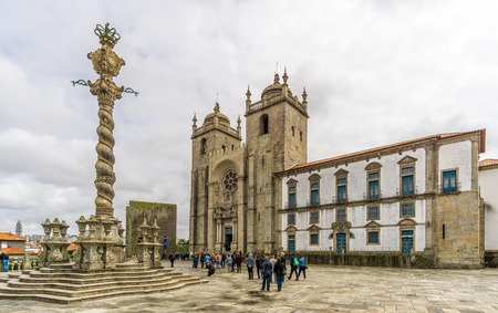 unesco world heritage site: PORTO,PORTUGAL - MAY 13,2017 - View at the Cathedral of Porto with pillory. Porto is one of the oldest European centres, and its historical core was proclaimed a World Heritage Site by UNESCO in 1996.
