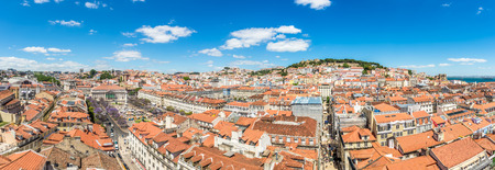 Panoramic view at the Rossio square and Alfama district from Santa Justa in Lisbon - Portugal