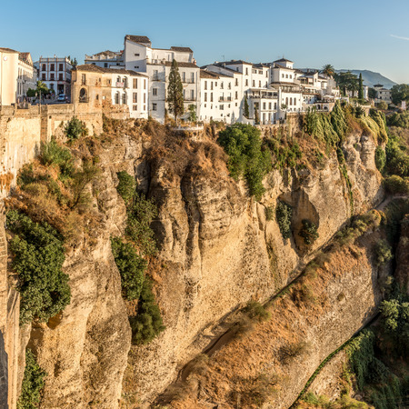 RONDA,SPAIN - SEPTEMBER 29,2017 - View at the old city of Ronda at the bottom of the El Tajo gorge. Ronda is a city in the Spanish province of Malaga.
