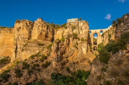 View at the rocks with El Tajo gorge with bridge (Puente Nuevo)in Ronda - Spain