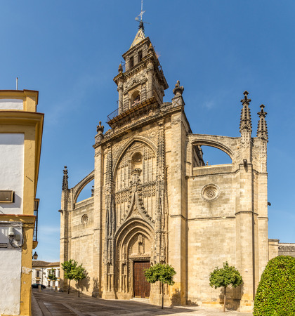 JEREZ DE LA FRONTERA, SPAIN - SEPTEMBER 30,2017 - View at the facade of Santiago church in the streets of Jerez de la Frontera. Jerez is known as the city of flamenco, sherry, horses and motorcycles.