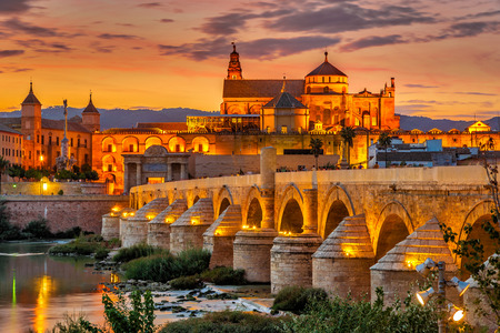 Evening view at the Mosque-Cathedral with Roman bridge in Cordoba - Spain