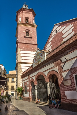 MALAGA,SPAIN - OCTOBER 5,2017 - View at the church of Martyrs Ciriaco and Paula in Malaga. Malaga is the second-most populous city of Andalusia and the sixth-largest in Spain.