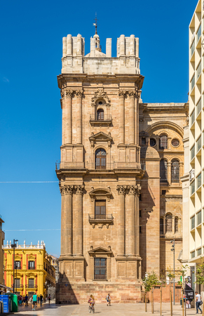 MALAGA,SPAIN - OCTOBER 5,2017 - View of the side tower of the cathedral in Malaga. Malaga is the second-most populous city of Andalusia and the sixth-largest in Spain.