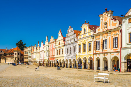 TELC, CZECH REPUBLIC - APRIL 18,2018 - View at the Painted houses at Main place in Telc. The town was founded in the 13th century. Redakční