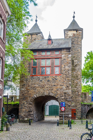 MAASTRICHT, NETHERLANDS - MAY 16,2018 - Old Gate (Helpoort) to Maastricht. Maastricht is the capital and the largest city in the province of Limburg.
