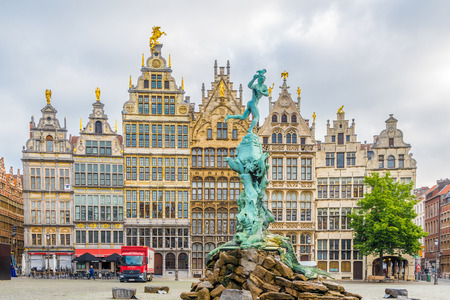 ANTWERP,BELGIUM - MAY 18,2018 - Brabo monument with Gildhouses at the Grote markt in Antwerp. Antwerp is a city in Belgium, and is the capital of Antwerp province in Flanders.