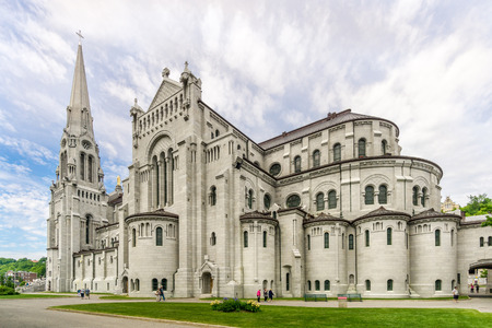 BEAUPRE,CANADA - JUNE 17,2018 - View at the Basilica of Sainte Anne de Beaupre. The basilica is known as a place of miracles. Редакционное