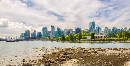 VANCOUVER,CANADA - JULY 6,2018 - View at the Vancouver downtown from Stanley Park. Vancouver is a coastal seaport city in western Canada, located in British Columbia. Sajtókép