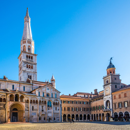 View at the Grande place with Ghirlandina tower of Cathedral and City hall in Modena, Italy