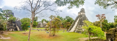 TIKAL, GUATEMALA - MARCH 7,2019 - Panoramic view of Tikal Temple and Temple II from the Acropolis in Tikal Natinal Park. Tikal is one of the largest archaeological sites and urban centers of the pre-Columbian Maya civilization.