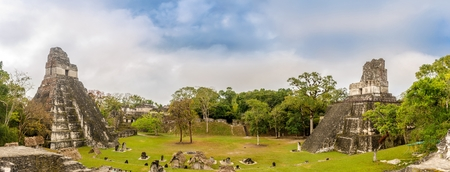Panoramic view at the Grand Place with Temple I and Temple II in Tikal National Park, Guatemala