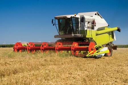 Modern combine in the field during harvesting Stock Photo - 7432061