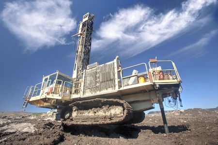 Heavy drilling machine at worksite  Stock Photo