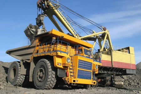 coal truck: A picture of a big yellow mining truck at worksite Stock Photo