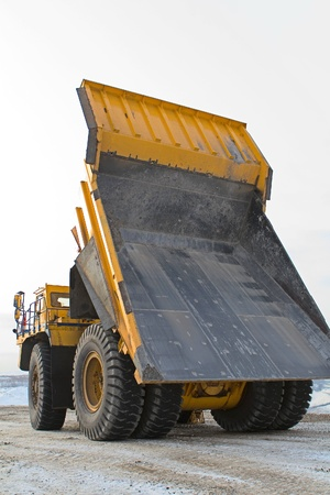 worksite: A picture of a big yellow mining truck at worksite Stock Photo