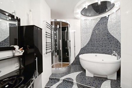 the bathroom in black and white style and a beautiful mosaic photo