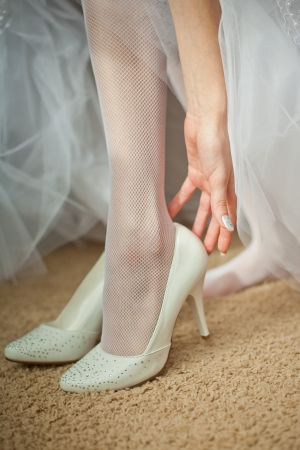 Beautiful leg of the young bride photo