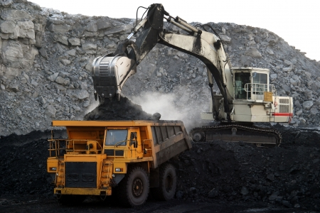 coal mine: A picture of a big yellow mining truck at worksite Stock Photo