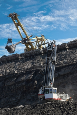 work in coal mine drill, coaches and excavator photo