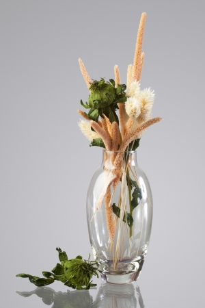 vase with a bouquet of dried flowers photo