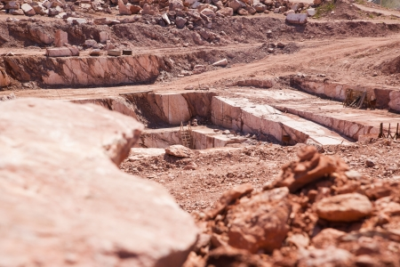 carrara: quarry red marble shot in sunny summer day Stock Photo