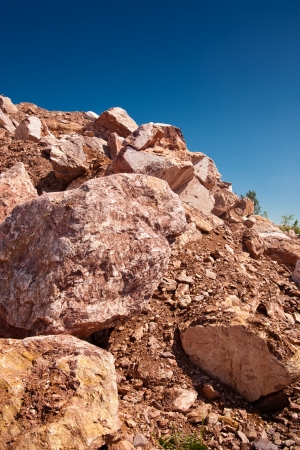 quarry red marble shot in sunny summer day photo