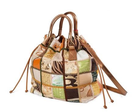 Lyxiga kvinnor handväska isolerat över vit