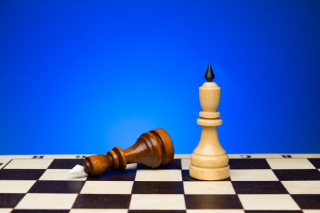 chessboard: Two chess king. Black lost the tournament. Chess board and blue background