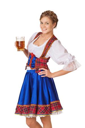 Junge sexy Oktoberfest Frau trägt einen traditionellen bayerischen Kleid Dirndl serviert Bier Becher Standard-Bild - 30174786