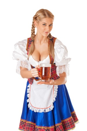 dirndl: Young sexy Oktoberfest woman wearing a traditional Bavarian dress dirndl serving beer mugs