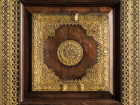 wood carving door: Beautiful Indian traditional interior and exterior ornament pattern made of gold and wood.