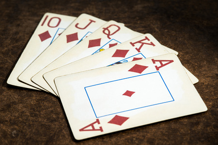 card game: old playing cards collected from a combination of poker royal flush Stock Photo