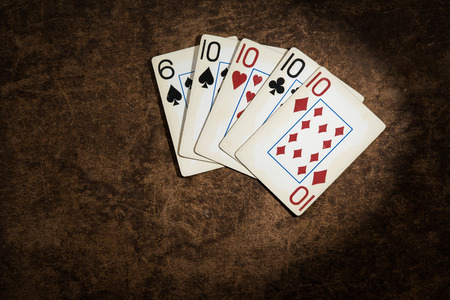 jack of diamonds: old playing cards collected from a combination of poker four-of-a-kind Stock Photo