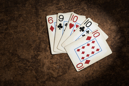 jack of diamonds: old playing cards collected from a combination of poker three-of-a-kind