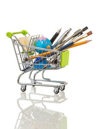 high resolution photo of trolley with school equipment on white background and a real reflection Stock Photo